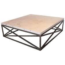 x motif base coffee table with jura grey limestone top