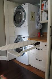 The best upgrade: fold-out ironing board drawer in the laundry. Full size  doors to laundry are retractable.