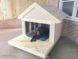 a dog in a wooden dog house with a porch diy girl cave