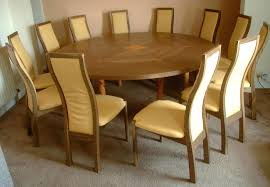 expanding circular dining table round fumed oak and yew extending chairs square mechanism