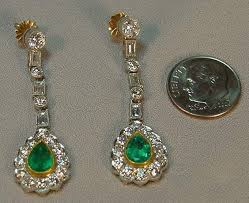 superb pair of beautifully designed art deco style diamond emerald 18k white and yellow gold chandelier earrings the emeralds are pear shaped natural gem