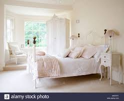 Pink And White Bedroom Pale Pink Silk Quilt And White Bedlinen On White Wrought Iron Bed