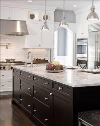 white subway tile backsplash with white kitchen cabinets