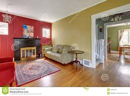 Yellow And Red Living Room Living Room With Red And Yellow Walls And Fireplace Stock Image