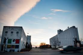 a mexican bakery sits along garden city s main street next to the main train station and grain elevator in the early morning