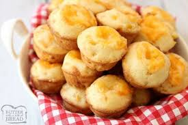 Cheesy Cornbread Muffins Butter With A Side Of Bread