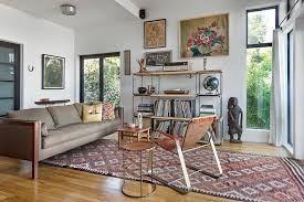 inspired kilim rugs in living room scandinavian with modern brown leather couch next to decorate with leather furniture alongside hanging rug and mixing