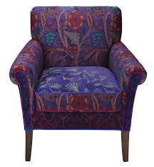 concord salon chair ottoman available in lilly fern and majorca fabric in deep purple reds teal with splashes of olive and orange legs are gany