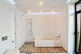 bath room beautiful tube white wooden floor stainless shower faucet glass partition door wall granite lighting ceiling lamp modern contemporary apartements ceiling wall shower lighting