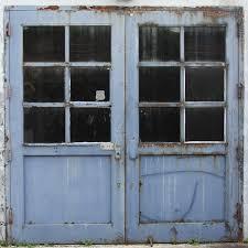 old windowed garage doors