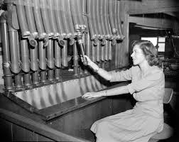 Tube office Lighting Open Original Digital Object Wade Asia Woman Using The Pneumatic Tube Delivery System At The Offices Of