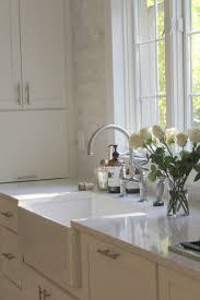 white classic kitchen with shaker cabinets marble subway tile viatera quartz countertop in minuet