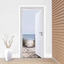 open door to the beach door mural