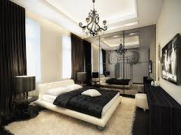 Iron Bedroom Chandelier Over White Upholstery Pltaform Bed With Cool Black And White Modern Bedroom Decor Collection
