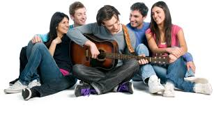 a group of people and one person playing the guitar