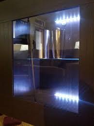 besta lighting. the shelf units with lights were mounted on wall top about waist high besta lighting u