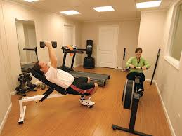a basement gym and workout room with a wood laminate flooring installed in st catharines