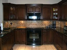 kitchen cabinets and countertops brown kitchen cabinets with dark and lighter colored tile and floors apex