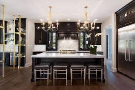 black kitchen with gold chandeliers
