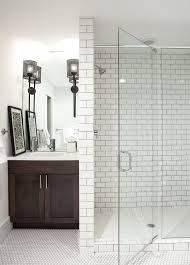 how to clean grout on tile floors with transitional bathroom and black wall sconces glass shower door hex tile hexagon tile single handle faucet white