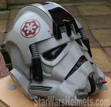 the helmet still has one of the original grey hoses which has one end affixed to one of the rear tanks the other side the owner usually loops round to