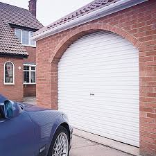 white steel roller garage door in arched opening