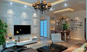appealing modern living room tv wall ideas with textured white wall and white chairs also cone hanging ceiling lamp plus black glass coffee table along with