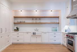 long rustic wood shelves over farmhouse kitchen sink