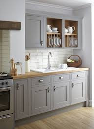 vintage grey kitchen is softened with wooden countertops and a subway tile backsplash makes it more