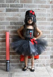 darth vader costume with a tutu skirt and a helmet