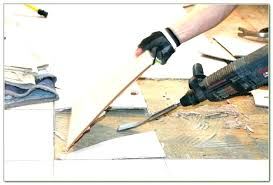 how to remove ceramic tile adhesive removing