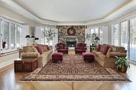 luxury family room with large carpet and rock fireplace
