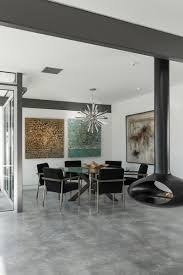 modern furnishings a decorative metallic pendant and colorful artwork decorate the dining space