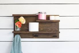 bathroom wall shelf with towel hooks