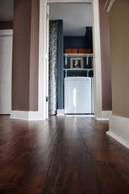 love the flooring from sam s club select surfaces cocoa walnut hand sed laminate love her paint choices as well the navy grey