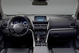 mitsubishi eclipse 2014 interior. the interior of eclipse is smart with a 7inch fixed screen sitting near top dashboard controls underneath are premium mitsubishi 2014