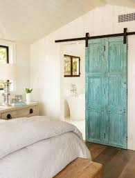 a turquoise sliding door adds color to the space and makes it welcoming