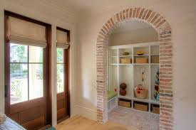Interior square arch design entry beach style with beamed ceilings
