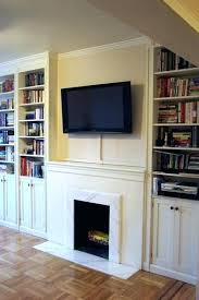 hide wires mounted tv above fireplace