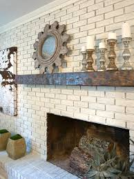 transitional white brick fireplace with brown wood mantel