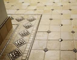 traditional bronze tile accent inset cream marble floor grid
