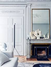 two ceramic sculptures found at an athens flea market are juxtaposed on the sitting room mantelpiece with a bird sculpture by ghyslain bertholon