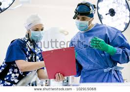 surgeon nurse surgeon nurse operating theater looking chart stock photo royalty