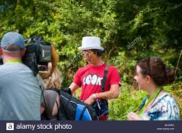 sound man and camera man interviewing pop star stock photo sound man and camera man interviewing pop star