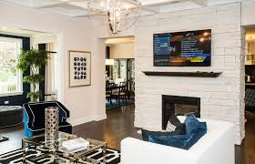contemporary living room with hardwood floors crown molding carpet pendant light metal