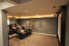 interior design home theater showing grey wall theme and black leather seat on of interior