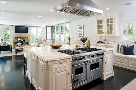 stainless steel vent hood. Amazing Kitchen Features A Stainless Steel Vent Hood Placed Directly Above An Extra Large Square .