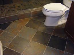 bathroom tiles floor. Marvelous Design Of The Grey Tile Floor Ideas Added With White Toilets And Brown Wooden Cabinets Bathroom Tiles T