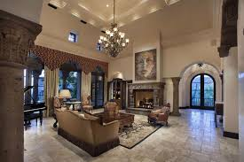 traditional luxury living room with arched windows decorative fireplace and elegant chandelier