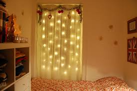 lighting curtains. for a bit of softer glow hang lights behind window curtains made from sheer fabric the will slightly dim as well create lighting